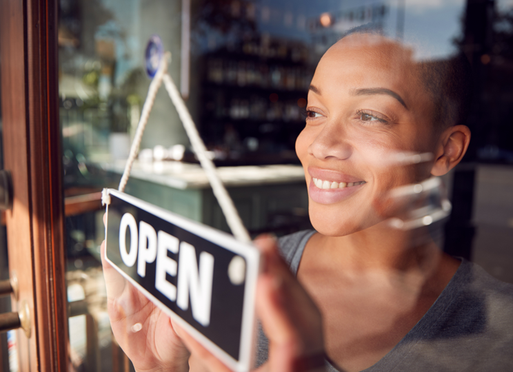 Business owner and open sign 744x540.png