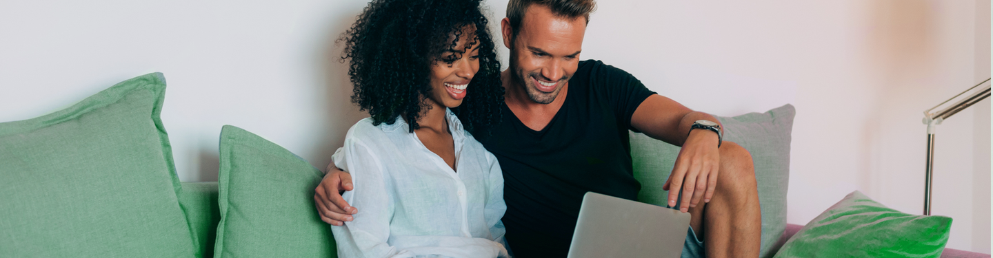 Couple looking at laptop 1920x500 .png